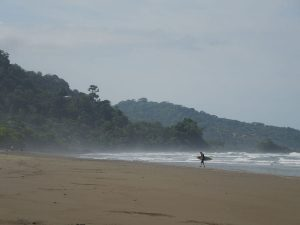 dominical-beach-surfer-distance